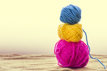 Balls of wool on background, old retro vintage style