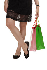 girl in black dress with shopping bag on white isolated background