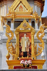 Bangkok, Thailand - December 21, 2011:  Photographic portrait of beloved King Bumibhol in a gilded frame at Wat Tramit in Chinatown