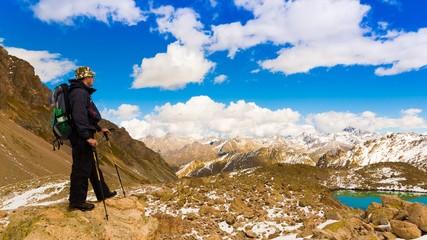 A man in mountain day autumn