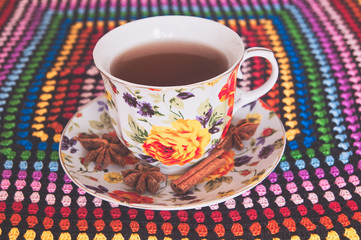Beautiful cup of tea on the colored tablecloth