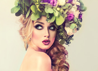 Girl spring . Beautiful model with flower wreath on his head . Makeup smoky eyes . Summer girl with trendy makeup .