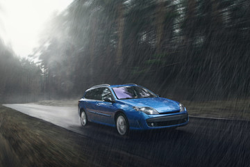 Wall Mural - Blue car fast drive on wet road in rain at daytime