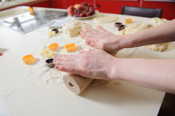Closeup of woman hand with rolling baking cookies