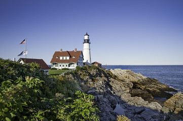 Portland Head Lighthouse on a bright sunny afternoon in Portland, Maine.