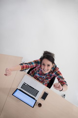 top view of young business woman working on laptop