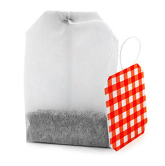 Teabag with red checkered label isolated on white background