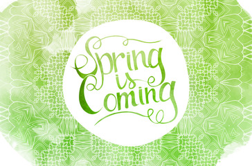 Green watercolor inscription spring is coming