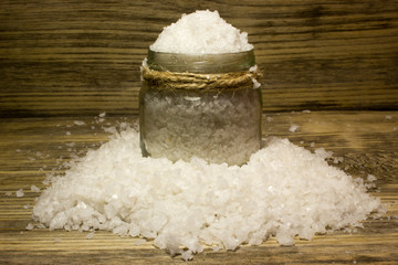 Large sea salt on wooden background