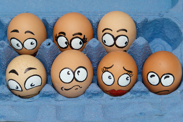Nine sad  frightened egg faces in blue panel