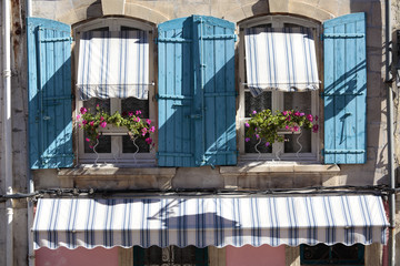 France provence style cottage windows, blue shutters and flower box