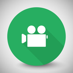 White Video Camera icon with long shadow on green circle