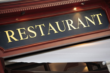 Paris French restaurant sign lit up at night