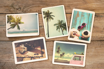 Summer photo album on wood table. instant photo of polaroid camera - vintage and retro style