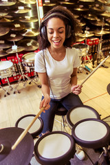 Woman playing electronic drums