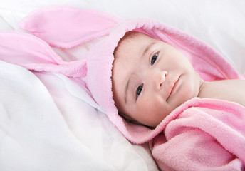 Baby in bunny costume on a white background