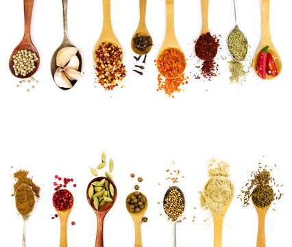 Spices in spoons isolated on white background.