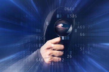 Spyware software, hooded hacker with magnifying glass analyzing