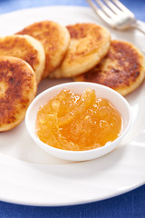 Cheese pancake on a plate with lemon jam