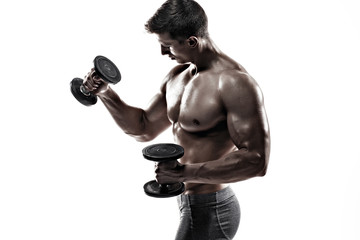 Athletic man showing muscular body and doing exercises with dumbbells