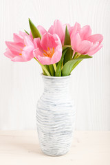 Fresh pink tulips in a  jug