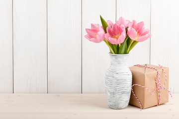 Fresh pink tulips and gift box