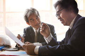 couples of senior partner business man meeting with serious prob