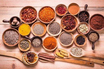 spices and herbs on wooden table , medicinal concept