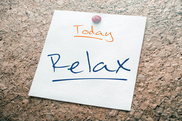 Relax Reminder For Today On Paper Pinned On Cork Board