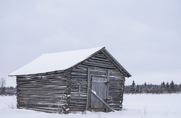 old barn in the winter landscape