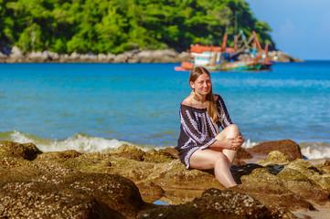 Joyful honeymoon couple playing on a beach in Phuket, Thailand