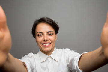 Attractive young woman takes a selfie