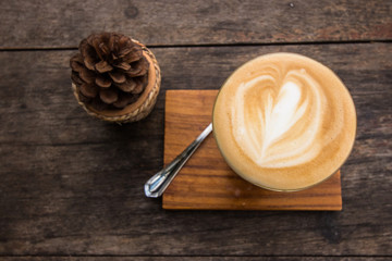 Top view of cappuccino coffee on wooden table