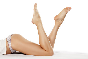 beautiful and pretty woman's legs on the bed