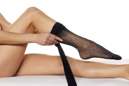 women pull on her nylon stockings