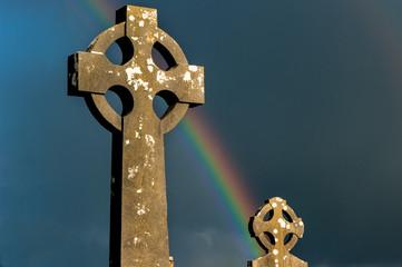 Rainbow over Irish celtic cemetery