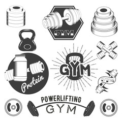 Set of gym labels in retro style. Sport fitness emblems, badges and logos for design. Vector illustration
