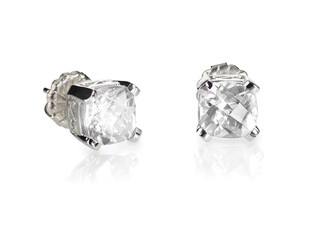 Pair of diamond stud cushion cut white quarts earrings isolated on white