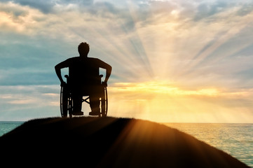 Silhouette of disabled person in a wheelchair