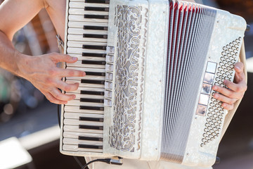 the man playing an accordion. accordion close up.