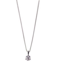 A beautiful diamond and white gold pendant dangles from a chain. Fine Jewelry necklace isolated on a white background with shadow and reflection