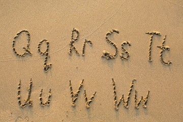 Alphabet written in light beach sand, part 3 of 4 (Q-W)