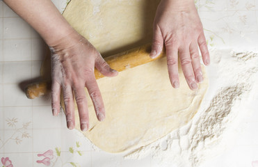 Making dough by female hands