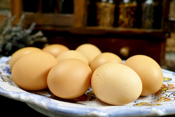Fresh eggs on  Vintage Wooden Spice Rack or Storage Cabinet back
