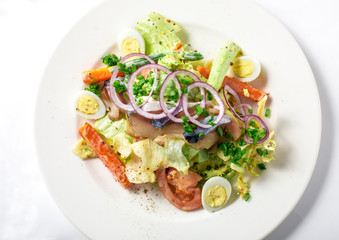 Salad with mackerel fish, zucchini, lettuce, carrots and creamy dressing