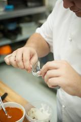 Chef prepares food