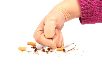 Woman's fist crushing cigarettes
