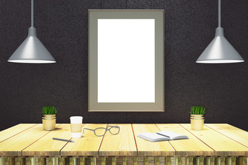 Blank rectangle picture frame on black wall with wooden table wi