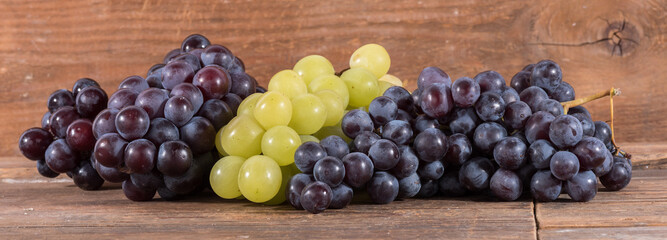 Bunches of white and black grapes
