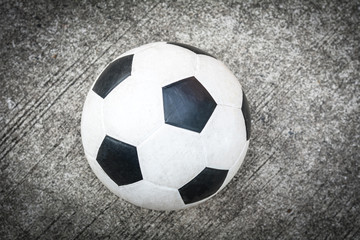 soccer ball on the cement floor.